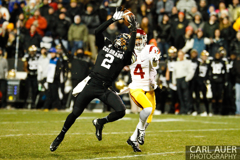 November 23rd, 2013:  Colorado Buffaloes freshman wide receiver Devin Ross (2) attempts to pull in a long pass in the second quarter of the NCAA Football game between the University of Southern California Trojans and the University of Colorado Buffaloes at Folsom Field in Boulder, Colorado