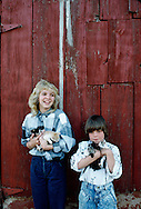 Sisters hold litter of kittens on Oklahoma farm, <br /> MODEL RELEASED, <br /> PROPERTY RELEASED