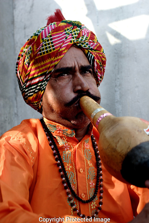 Sheesha Nath plays his snake charming pipe known as a Bean in the Indian state of Uttar Pradesh on 4th Dec 2006..56 yr old Sheesha comes from a family of charmers that have been in the business for as long as anyone can remember. .He says of charming, 'the future does not look good for charmers, its just not sustainable these days. The situation has become so bad that charmers cannot even afford to send their children to school'..