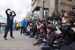 © Licensed to London News Pictures. 18/04/2013. London, England. Picture: Mo Farah, British Runner, double Olympic gold medallist, who will attempt a half marathon on 21 April is posing for photographers. Virgin London Marathon - Photocall with British Marathon Runners Athletes Scott Overall, Amy Whitehead and Mo Farah at Tower Bridge, London, ahead of Sunday's race. Photo credit: Bettina Strenske/LNP