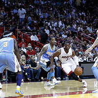 19 March 2011: Miami Heat shooting guard Dwyane Wade (3) drives past Denver Nuggets shooting guard J.R. Smith (5) during the Miami Heat 103-98 victory over the Denver Nuggets at the AmericanAirlines Arena, Miami, Florida, USA.