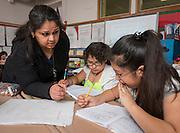 Rashmi Vashistha works with her math students at Golfcrest Elementary School, April 18, 2014.