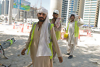 Immigrant workers in Dubai. Immigrants constitute nearly 90% of the population. Dubai, one of the seven emirates and the most populous of the United Arab Emirates sits on the southern coast of the Persian gulf.