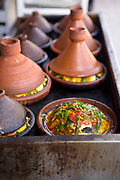 Tagines slow cook at roadside street food stall, Bab Doukkala, Marrakech, Morocco, 2018–03-20.