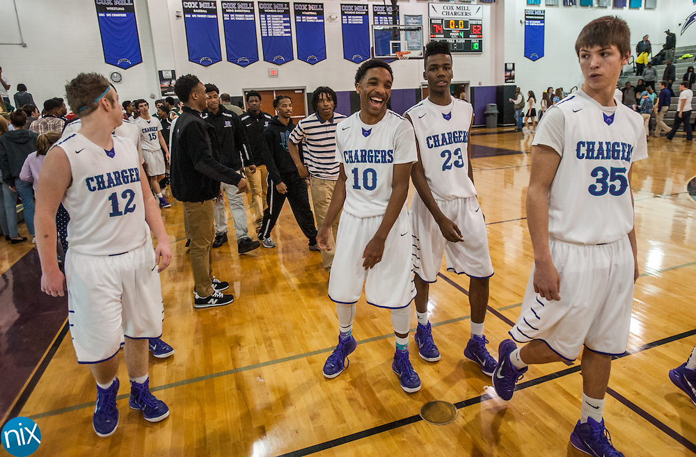 Cox Mill's Matt Morgan (10) and his teammates walk off the court after defeating A.C. Reynolds during a first round NCHSAA playoff game at Cox Mill High School Friday afternoon. Cox Mil won the game 74-62.