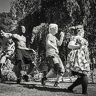 Young people dansing with joy in the summer heat in  Hermansverk, Sogn og fjordane Norway