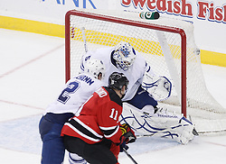 Feb 5, 2010; Newark, NJ, USA; New Jersey Devils left wing Dean McAmmond (11) scores a goal past Toronto Maple Leafs goalie Jonas Gustavsson (50) during the third period at the Prudential Center. The Devils rallied with three goals in the period to win 4-3.