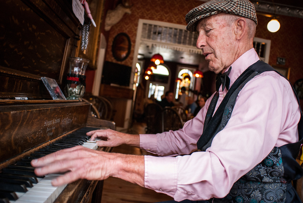 Piano player Dale Elliot plays a shift at the historic saloon on Greene Street, downtown Silverton, Colorado.