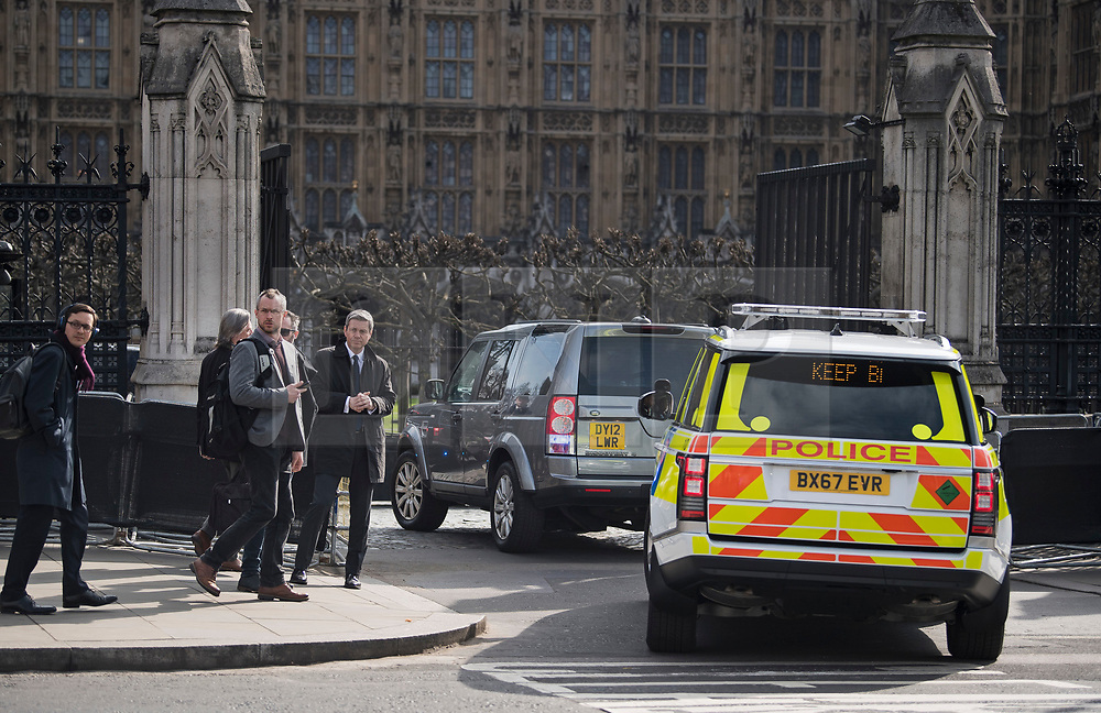 © Licensed to London News Pictures. 22/03/2018. London, UK. A convoy of vehicles carrying British Prime Minister arrives through Carriage Gate at the Houses of Parliament in Westminster, London on the one year anniversary of the Westminster Bridge Terror attack in which lone terrorist killed 5 people and injured several more, in an attack using a car and a knife. The attacker, 52-year-old Briton Khalid Masood, managed to gain entry to the grounds of the Houses of Parliament and killed police officer Keith Palmer. Photo credit: Ben Cawthra/LNP