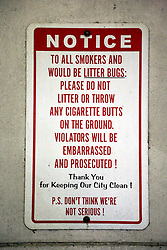 12 June  2015. New Orleans, Louisiana. <br /> An anti litter sign on the wall outside Civil District Court. Photo©; Charlie Varley/varleypix.com