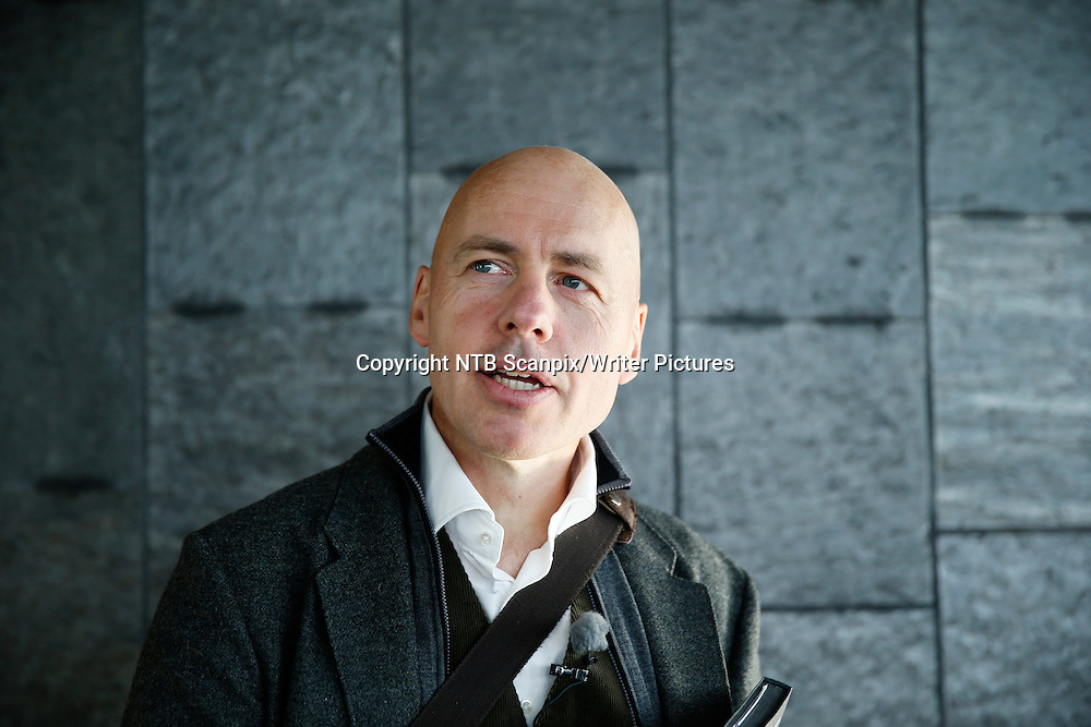 OSLO  20130917.<br /> Regjeringsbygget H&macr;yblokka 17. september 2013 <br /> Forfatteren boka H&macr;yblokka Hugo Lauritz Jenssen<br /> 22. juli 2011 ble regjeringskartalet og h&macr;yblokka rammet av en terroraksjon utf&macr;rt av Anders Behring Breivik. 8 mennesker omkom. H&macr;yblokka med statsministerens kontor p&Acirc; toppen er n&Acirc; t&macr;mt og ryddet men sporene etter hendelsen er fortsatt tydelige.<br /> Foto: Cornelius Poppe / NTB scanpix<br /> <br /> NTB Scanpix/Writer Pictures<br /> <br /> WORLD RIGHTS, DIRECT SALES ONLY, NO AGENCY