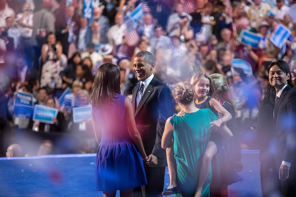 President Barack Obama laughs with his daughter Malia after speaking at the Democratic National Convention on Thursday, September 6, 2012 in Charlotte, NC.