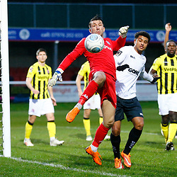 AFC Fylde's keeper Jay Lynch hooks the ball away from Dover's forward Jamie Allen during the National League match between Dover Athletic FC and AFC Flyde at Crabble Stadium, Kent on 08 December 2018. Photo by Matt Bristow.