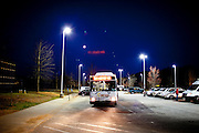 A CTRAN bus approaches a bus stop before dawn outside of The Harold R. Banke Justice Center in Jonesboro, Georgia March 31, 2010. March 31, 2010 marked Clayton County, Georgia's last day of the county's public bus system, CTRAN, running.