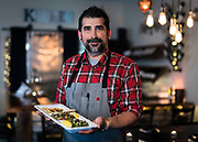 """Meze Mediterranean Cuisine's owner Ozgur """"Figo"""" Akcay poses for a portrait in Sun Praire, WI on Thursday, May 2, 2019."""