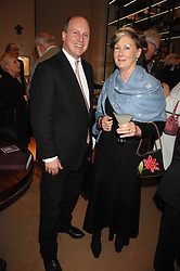JAMES PALMER-TOMKINSON and his mother PATTI PALMER-TOMKINSON at a party to celebrate the publication of 'Young Stalin' by Simon Sebag-Montefiore at Asprey, New Bond Street, London on 14th May 2007.<br />