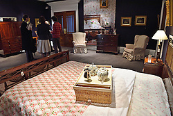 © Licensed to London News Pictures. 26/03/2016.  An Edwardian carved mahogany and cane bedhead and footbed, early 20th century on display with an estimate of £800-1,000. The Duchess of Devonshire press preview at Sotheby's auction house.  The Duchess, Deborah Mitford, was the youngest surviving member of the six Mitford sisters, and died in September 2014. London, UK. Photo credit: Ray Tang/LNP
