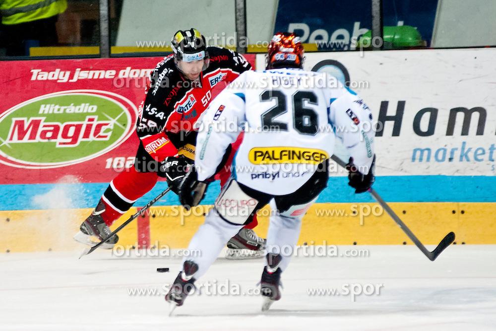 26.12.2013, Hostan Arena, Zneim, CZE, EBEL, HC Orli Znojmo vs EHC Black Wings Linz, 58. Runde, im Bild Richard Pavlikovsky (HC Orli Znojmo #50) Rob Hisey (Linz #26) // Richard Pavlikovsky (HC Orli Znojmo #50) Rob Hisey (Linz #26) during the Erste Bank Icehockey League 58th round match between HC Orli Znojmo and EHC Black Wings Linz at the Hostan Arena in Zneim, Czech Republic on 2013/12/26. EXPA Pictures © 2013, PhotoCredit: EXPA/ Rostislav Pfeffer