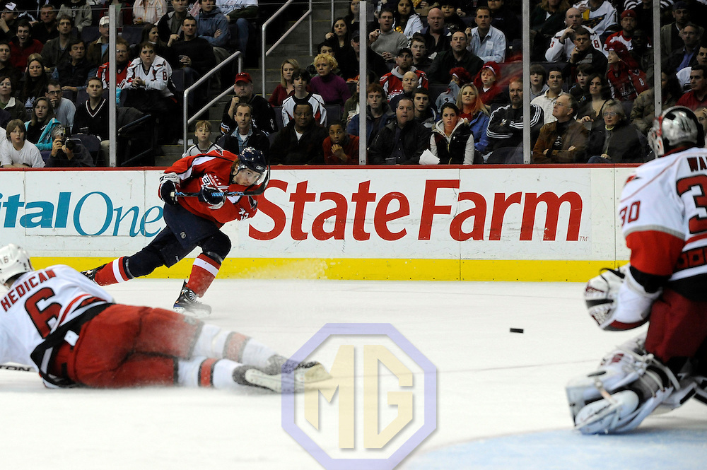 08 February 2008:  Washington Capitals right wing Tomas Fleischmann (43) fires a shot that is stopped by Carolina Hurricanes goalie Cam Ward (30) in the first period at the Verizon Center in Washington, D.C.  The Hurricanes defeated the Capitals  2-1.