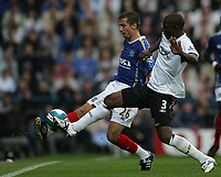 Photo: Lee Earle.<br /> Portsmouth v Bolton Wanderers. The FA Barclays Premiership. 18/08/2007.Bolton's J Lloyd Samuel (R) battles with Gary O'Neil.