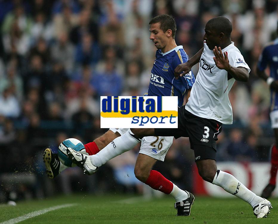 Photo: Lee Earle.<br /> Portsmouth v Bolton Wanderers. The FA Barclays Premiership. 18/08/2007.Bolton's J Lloyd Samuel (R) battles with Gary O'Neil.