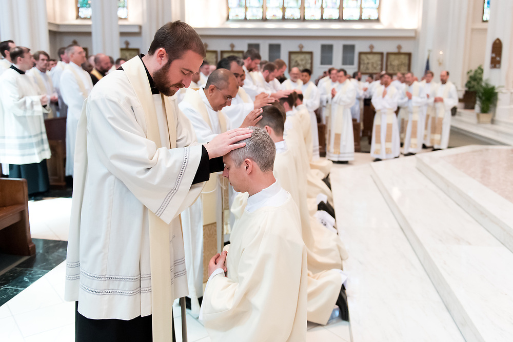 DENVER, CO - MAY 13: Fr. Scott Bailey lays his hands upon Peter Wojda during his ordination to the priesthood at Cathedral Basilica of the Immaculate Conception on May 13, 2017, in Denver, Colorado. (Photo by Daniel Petty/for Denver Catholic)