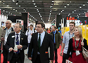 .Dr. Stephen Farry Employment and Learning Minister for Northern Ireland is shown around  the ExCel Centre with entourage  in London on October 8th 2011.
