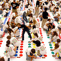 About 450 participants play Twister on 180 mats on Sunday night gathered in Great Hall at the Fargo Holiday Inn in hopes of making the Guinness Book of World Records for breaking the record for the largest Twister board played on measuring at 4699 square feet. The record to beat is 2453 square feet. The participants are a part of the North Dakota DECA club that focuses on improving educational and career opportunities in marketing, management and entrepreneurship.