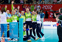 Danica Gosnak of Slovenia, Marinka Cencelj of Slovenia, Anita Goltnik Urnaut of Slovenia, Suzana Ocepek of Slovenia and Lena Gabrscek of Slovenia celebrate after winning the 5th - 8th place sitting volleyball match between National teams of Slovenia and Japan during Day 7 of the Summer Paralympic Games London 2012 on September 4, 2012, in ExCel Exhibition centre, London, Great Britain. Slovenia defeated Japan 3-0. (Photo by Vid Ponikvar / Sportida.com)