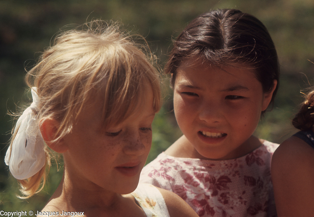 USSR (Union of Soviet Socialist Republics) 1968. Siberia. Two girls, one Russian, one from a native Siberian ethnic group.
