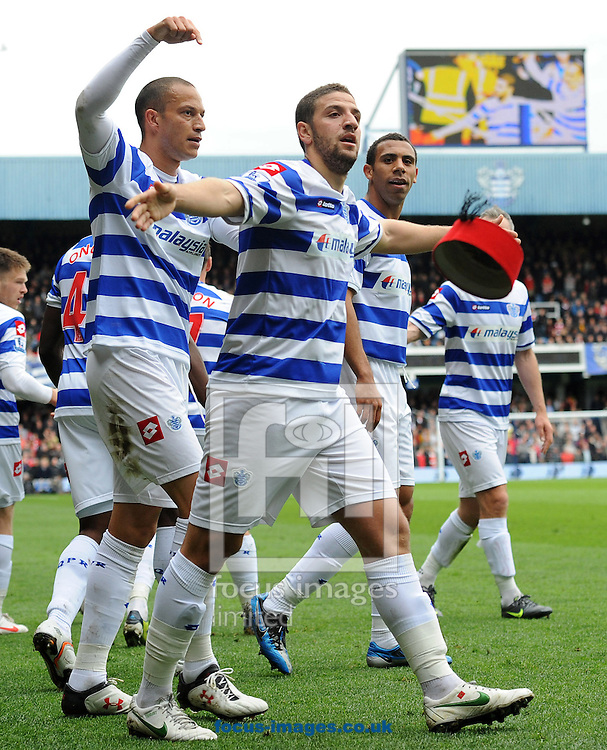Picture by Andrew Timms/Focus Images Ltd. 07917 236526.31/03/12.Bobby Zamora, Adel Taarabt & Anton Ferdinand of Queens Park Rangers celebrate Adel Taarabt scoring QPR's first goal during the Barclays Premier League match against Arsenal at Loftus Road stadium, London.