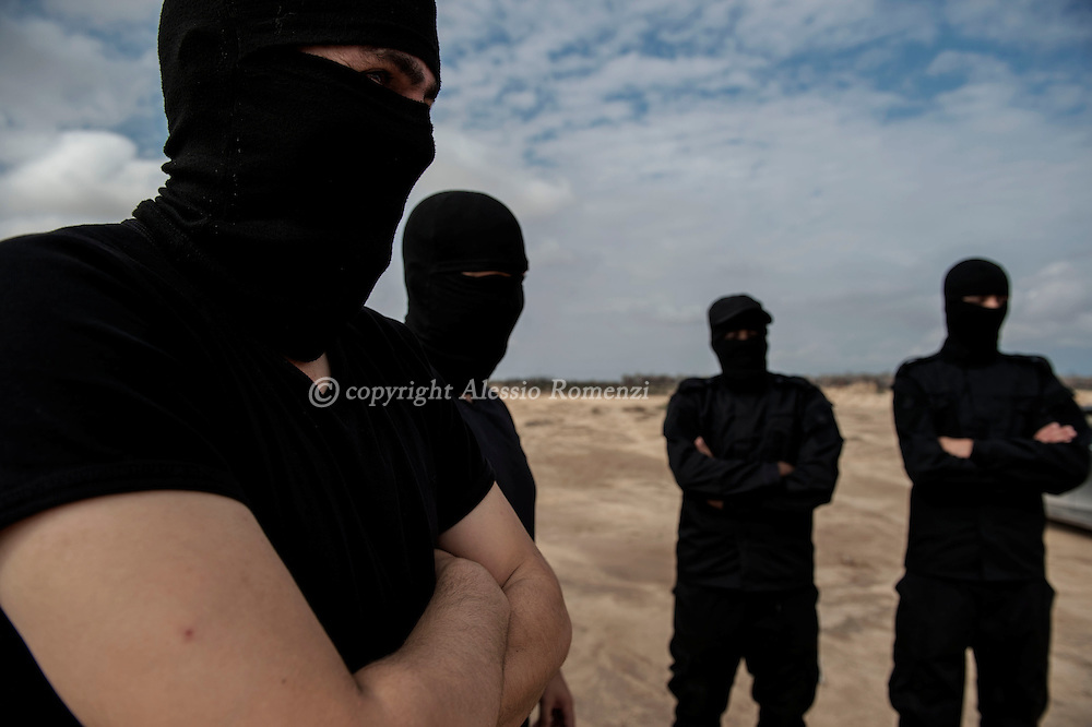 Libya, Zuwara: Members of the Black Masks volunteer special forces are seen in the city of Zuwara. Alessio Romenzi