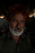 A portrait of Alibhux Babar, age 40, who's whole family enslaved for 14 years for borrowing US$143. <br /> <br /> Following the release of the Global Slavery Index by the Walk Free Foundation Pakistan is ranked 3rd worse in the world behind India and China. The Asian Development Bank estimates some 1.8 million people are slaves in Pakistan yet other estimates reach up to 4 million people, most of which toil year after year in brick kilns or sugar cane plantations. Their stories are the same; they have no-where to turn so they borrow money from a land-owner for a medical emergency or marriage dowry. The landlords pay in return for work, their labour supposed to be taken off the amount borrowed. Yet after years of no salary incredibly their amount owed is often quadrupled, the excuse being the amount they cost to feed! Many are chained, abused, raped and even killed.<br /> <br /> For years they had no where to run, no one to help but now a small local NGO called the Green Development Rural Organisation (GDRO) works to free bonded-slaves by using the law against their captives. Yet, often freed slaves end up right back where they were or risk being hunted by the landowner and forced to return. So GRDO started building villages so slaves who escape or are freed have somewhere safe to go. It now has two, whose names translate from Urdu as 'Village of the Freed' and 'Village of the Courageous', and is working on a 3rd. The land is bought and allocated to freed slave families where they can built a house and start again. Without such help the vicious cycle would continue.
