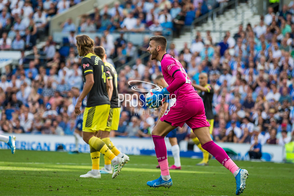 Angus Gunn (GK) (Southampton) in action during the Premier League match between Brighton and Hove Albion and Southampton at the American Express Community Stadium, Brighton and Hove, England on 24 August 2019.