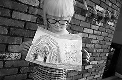 Lotus Hoben makes a card for family friends while social distancing during the coronavirus pandemic in the Hudson Valley, New York. Forest and Lotus Hoben, ages 10 and 6, were adopted from China and have albinism, a rare group of genetic disorders that cause the skin, hair, or eyes to have little or no color. Albinism is also associated with vision problems. According to the National Organization for Albinism and Hypopigmentation, about 1 in 18,000 to 20,000 people in the United States have a form of albinism.