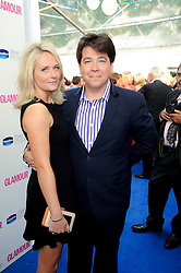 MICHAEL MCINTYRE and his wife KITTY at the Glamour Women Of The Year Awards held in Berkeley Square, London on 8th June 2010.