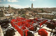 MOROCCO, FEZ 'old city' skyline with dyed wool  hanging on drying frames on rooftops