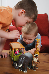 Boys playing with safari animal toys