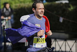 November 13, 2016 - Athens, Attica, Greece - A runner is wrapped in a French flag. Thousands of people from all over the world took part in the 2016 Athens Marathon the Authentic, which starts in the town of Marathon and is ending in Athens, the route, which according to legend was first run by the Greek messenger Pheidippides in 490 BC. (Credit Image: © Michael Debets/Pacific Press via ZUMA Wire)