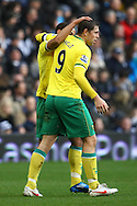 Picture by Paul Chesterton/Focus Images Ltd.  07904 640267.28/01/12.Grant Holt of Norwich City opens the scoring and celebrates with Elliott Bennett during the FA Cup fourth round match at The Hawthorns Stadium, West Bromwich.
