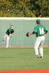 21 April 2015:  Tim Coonan throws the ball from the warning track back to cutoff man Jarrod Juskiewicz during an NCAA Inter-Division Baseball game between the Illinois Wesleyan Titans and the Illinois State Redbirds in Duffy Bass Field, Normal IL