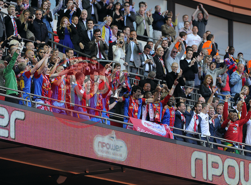 Crystal Palace payers lift the trophy - Photo mandatory by-line: Joe Meredith/JMP - Tel: Mobile: 07966 386802 27/05/2013 - SPORT - FOOTBALL - CHAMPIONSHIP - PLAY OFF - FINAL - Wembley Stadium - London - Crystal Palace V Watford