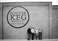 Family portrait in Niwot, black and white with lots of attitude, brick wall.