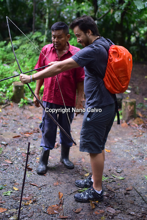 Catato L&oacute;pez, a Bribri man, explaining the use of a handmade bow. <br /> <br /> A day with the Bribri, indigenous people in Lim&oacute;n Province of Costa Rica.