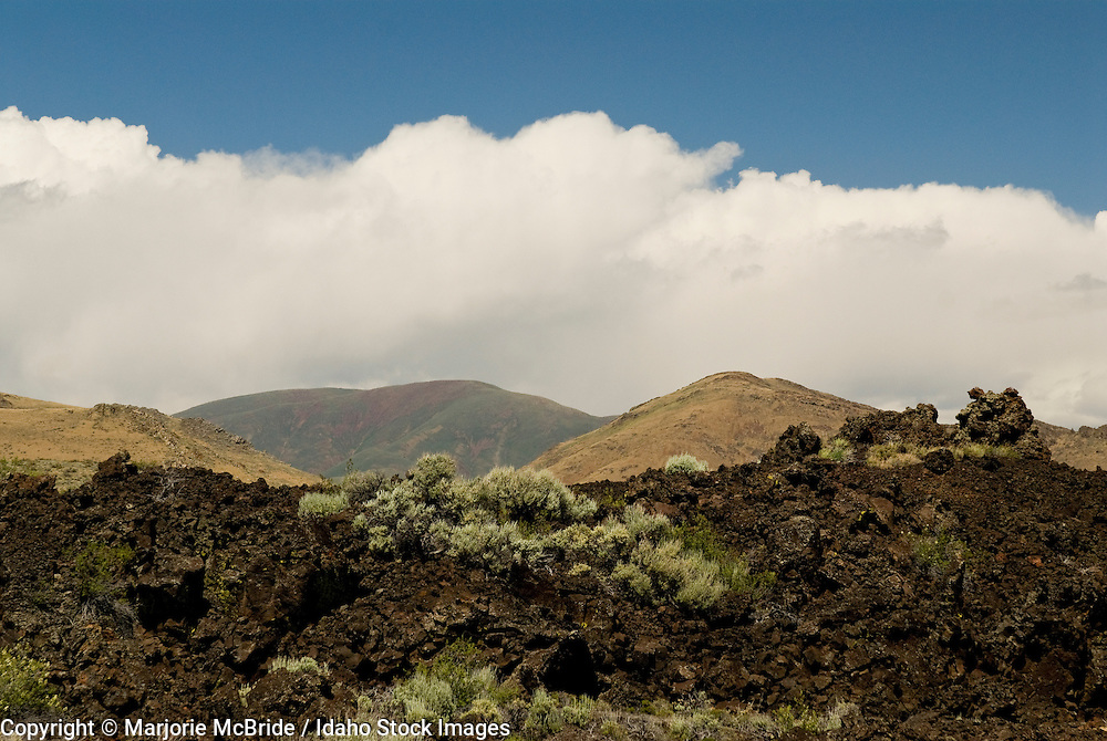 Sage and lava rock landscape with view of the White Knob Mountain Range along the Craters of the Moon Scenic byway, near Arco, Idaho.