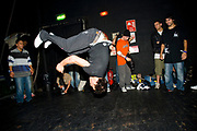 A boy dancing, captured head down in the middle of the air. UK B-Boy championships 06. 08/10/2006