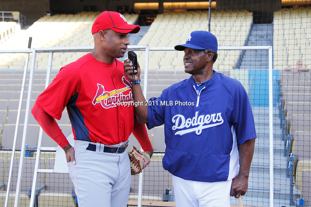LOS ANGELES, CA - APRIL 15:  Pitcher Miguel Batista #44 of the St. Louis Cardinals is interviewed by coach Manny Mota #11 of the Los Angeles Dodgers before the game between the St. Louis Cardinals and the Los Angeles Dodgers on Friday April 15, 2011 at Dodger Stadium in Los Angeles, California. (Photo by Paul Spinelli/MLB Photos via Getty Images) *** Local Caption *** Miguel Batista;Manny Mota