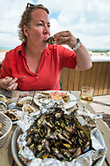 Charente Maritime, France, July 2019. Fresh oysters and seafood at Les Copains Babord, La Flotte, Ile de Re. The islands of Ile de Re and Ile d'Oleron are made for relaxation, and light cycling tours along beached, forests, oyster farms and salt pans. Photo by Frits Meyst / MeystPhoto.com