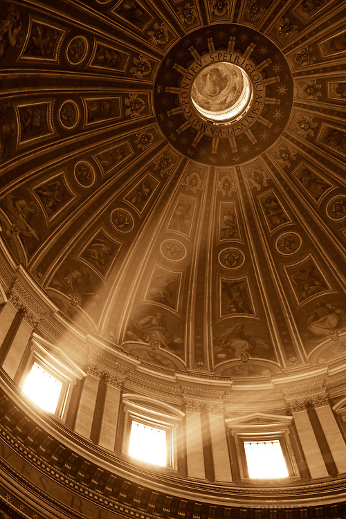 Light rays shining through the windows in the dome of St. Peter's Basilica, the Vatican.<br /> <br /> + ART PRINTS +<br /> To order prints or cards of this image, visit:<br /> http://greg-stechishin.artistwebsites.com/featured/illuminated-greg-stechishin.html