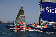 Italy's +39 Challenge hoists genoa jib as they prepare for America's Cup fleet race; Valencia, Spain.